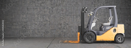 Photo  Forklift standing on industrial dirty concrete wall background