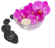 zen stones and orchids with candle