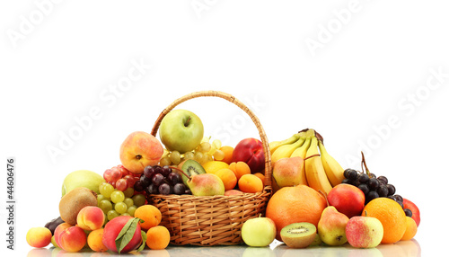 Poster Fruit Assortment of exotic fruits in basket isolated on white