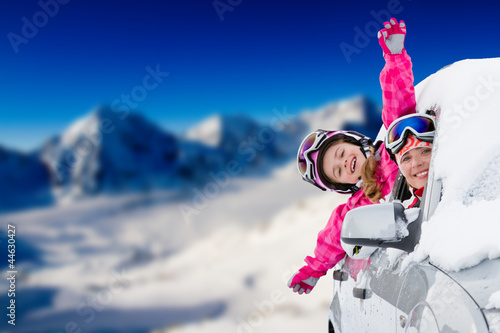 Fotobehang Wintersporten Winter holiday - happy family on the road for winter holidays