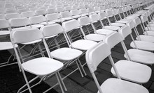 Rows Of White Plastic Chairs