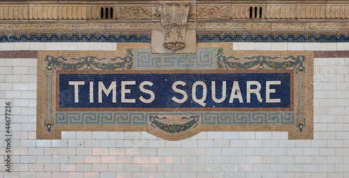 Photo  Times Square - New York city subway sign tile pattern