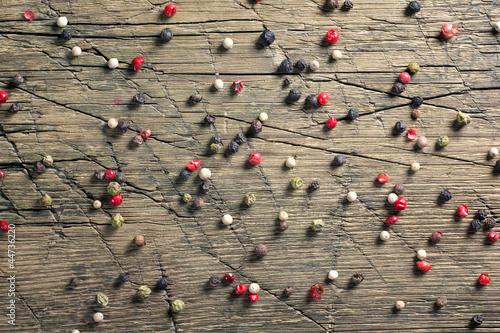 Peppercorn mix on vintage worn wood background