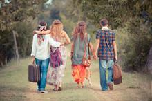 Hippie Group Walking On A Coun...
