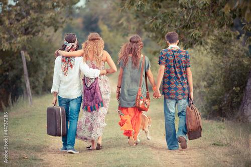 Fotografie, Obraz  Hippie Group Walking on a Countryside Road