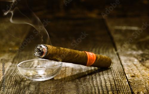 Photo  Burning luxury Cuban cigar