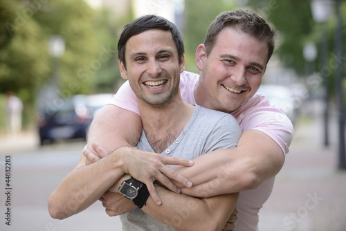 Obraz na plátně Happy gay couple outdoors