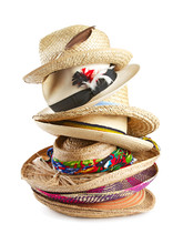 Variety Of Straw Hats Stacked Vertically