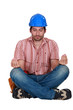 A construction worker in a yoga position.