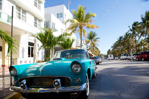 Photo Stands Old cars View of Ocean drive with a vintage car