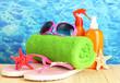 bright beach accessories, on blue sea background