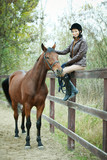 Fototapeta Konie - Woman jockey