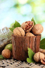 Walnuts With Green Leaves In G...