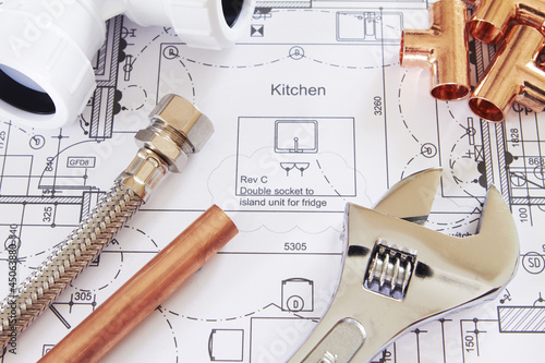 Plumbing Tools Arranged On House Plans