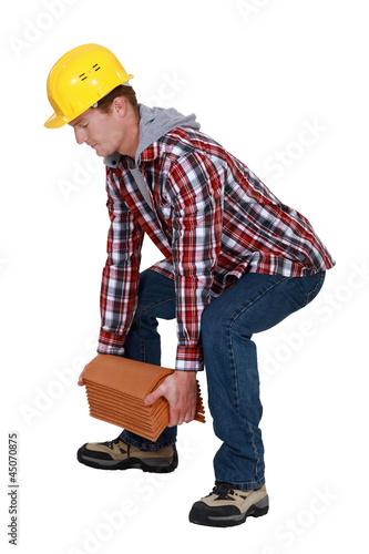 Fotografie, Obraz  Tradesman lifting shingles