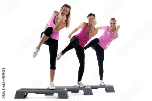 Foto-Stoff bedruckt - young group women training on stepper isolated (von Wisky)