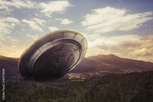 Foto op Canvas UFO UFO crashing on a valley