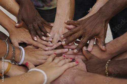 Fotografia, Obraz Many hands together: group of people joining hands