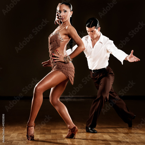 Tuinposter Dance School latino dance couple in action