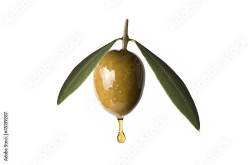 Photo Aceituna con hojas goteando aceite de oliva