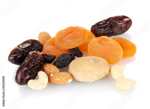 different dried fruits isolated on white - Buy this stock