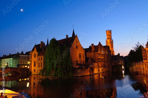 Deurstickers Brugge View from the Rozenhoedkaai at the Old Town of Bruges at dusk