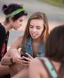 Cute Teen Girls Using Phone