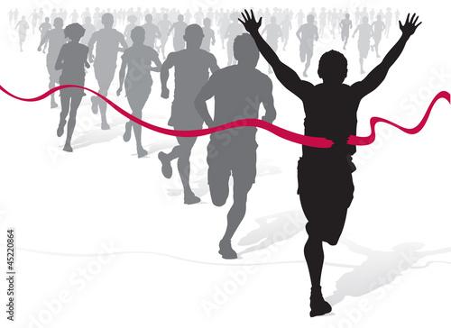 Fotografia  Winning Athlete ahead of a group of marathon runners.