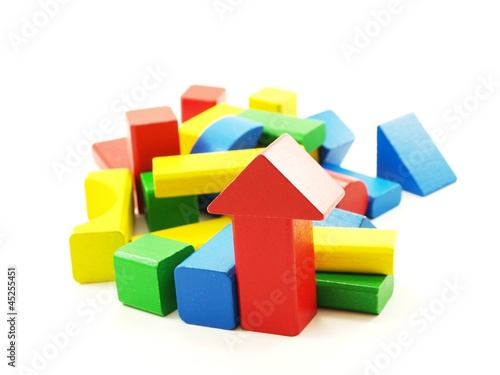 Pile of colorful wooden bricks, isolated towards white - Buy