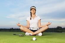 Girl Golfer Sitting In Yoga Po...