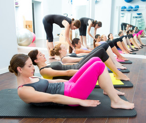 Fototapeta Aerobic Pilates personal trainer in a gym group class