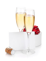 Champagne glasses, empty card and gift