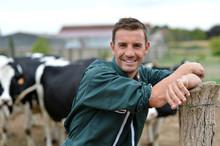 Herdsman Standing In Front Of ...