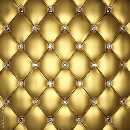 zlota-skorzana-tapicerka-z-diamentowymi-guzikami