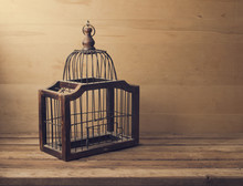 Wooden Empty Bird Cage On Wooden Table And Background