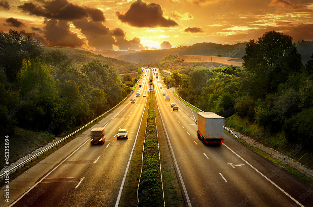 Fototapety, obrazy: Highway trafin in sunset