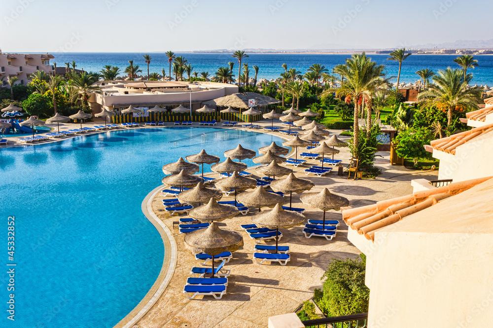 Fototapeta  the pool, beach umbrellas and the Red Sea in Egypt