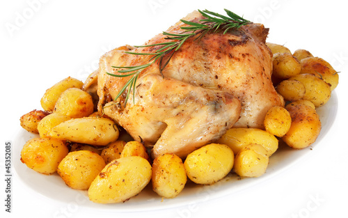 Valokuva  Delicious roast chicken with potatoes on white background