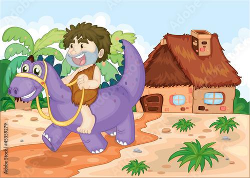 Tuinposter Dinosaurs a boy riding on dinosaur