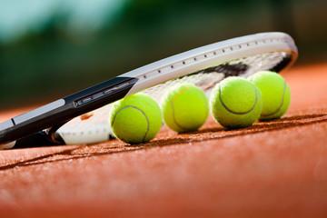 Fototapeta Close up view of tennis racket and balls