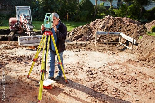Fotografie, Obraz  land surveyor, geodesist at work