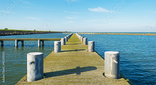 Tuinposter Pier Jetty in a lake in autumn