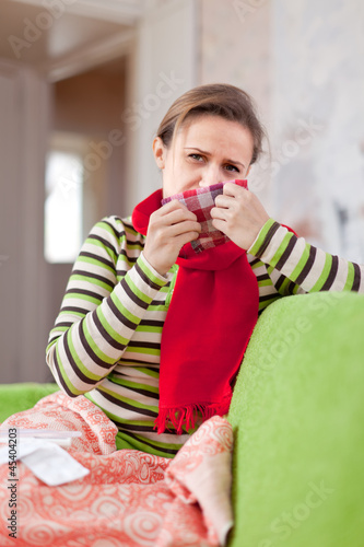 sick woman uses handkerchief Canvas Print
