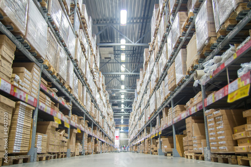Photo  Rows of shelves with boxes in modern warehouse