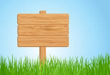 Wooden Sign On Green Grass