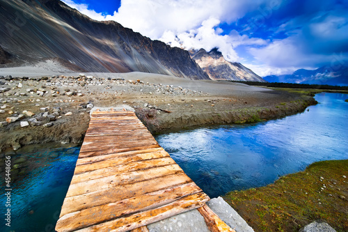 Fotografie, Obraz  Mountain landscape view with river and wooden bridge
