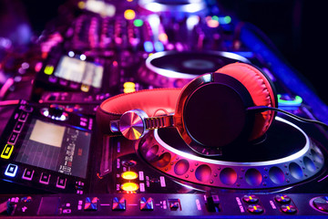 Fototapeta na wymiar Dj mixer with headphones