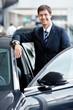 Businessman near cars