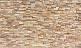 Fototapeta Kamienie - Stacked stone wall