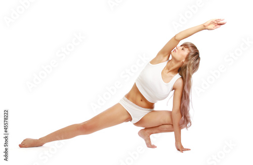 Fototapeta A young woman doing yoga, isolated on white obraz na płótnie